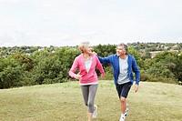 Mature man holding onto jogging partner
