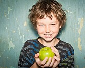 Boy holding apple