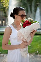 Young woman smelling flower bouquet