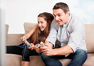 Daughter and father playing video game