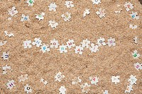 Jigsaw puzzle on the sand.