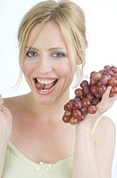 Woman eating wine grapes