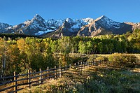 Sneffles Range at Dallas Divide in fall with rail feince in the San Juan Mountains in Colorado