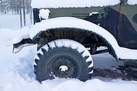 truck front tyre in snow