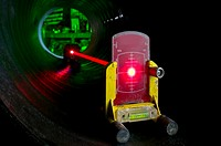 Studio image of laser level aimed towards the target. These levels are used for infrastructure construction