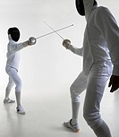 Studio portrait of fighting fencers