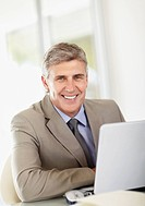 Portrait of businessman with laptop