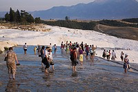 Tourists visiting the Travertine Terraces at Pamukkale, Aegean region, Turkey