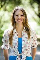 Smiling Hispanic woman outdoors