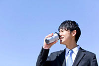 Businessman drinking water