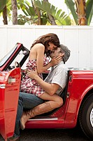 Couple kissing in vintage car