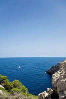 Sailboat and cliffs on Mediterranean Coast