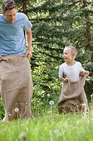 Father and son having a sack race