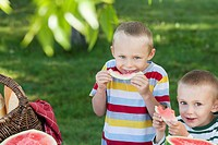 Little boys eating watermelon