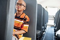 Boy riding school bus