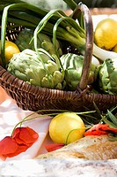 Basket with artichokes, lemon and green onions (thumbnail)