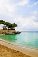Beach house and placid water on Mediterranean Coast