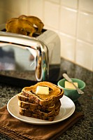 Stack of toasted bread with butter (thumbnail)