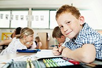 Boy studying in classroom