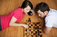 Young couple playing chess (thumbnail)