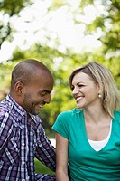 Young couple having a chat in a park (thumbnail)