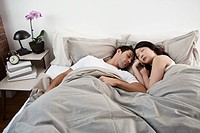 Young couple asleep