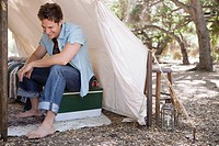 Man sitting in tent (thumbnail)
