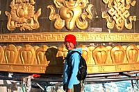 An eye-catching 24-meter (80-foot) tall golden prayer wheel sits on a hill. Though it was built recently for the sake of tourism, it has become an aut...