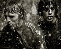 Two Young Men Caught in the Rain