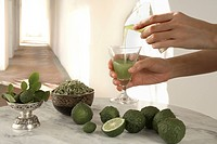 Kaffir lime, also known as limau purut, a type of lime native to Indonesia, Malaysia, and Thailand, and commonly used in Southeast Asian cuisine. The ...
