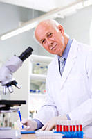 Male scientist doing research in laboratory, portrait