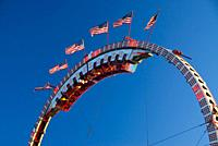 Super Loops carnival ride with flags, Oregon State Fair, Salem, OR