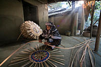 A woman making wicker basket at Suriya's house Suraiya is a widow from Shadipur in Sonargaon She has four daughters and two sons She borrowed 100,000 ...