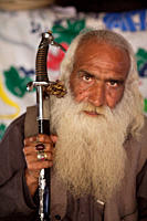 Sitting inside his tent, Khalid Bab holds a traditional sword He heals pains and cure diseases with his spiritual powers that he claims to have He liv...