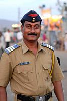 A man from the Maharashtra Police, at a village fair or ´haat´, near Nagpur, Maharashtra, India January 28, 2007