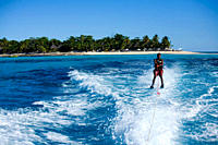 Waterskiing in the Indian Ocean, off the Nosy Iranja, a small island shaped like the letter T with a drag, on the north_western coast of Madagascar Ju...