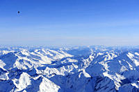 Hot_air balloon flying high above Zillertal range with Schrammacher and Hochfeiler in winter, aerial photo, Zillertal range, South Tyrol, Italy, Europ...