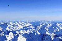 Hot_air balloon flying high above Zillertal range with Schrammacher and Hochfeiler in winter, aerial photo, Zillertal range, South Tyrol, Italy, Europ...