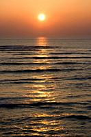 Sunset on the ocean along the french shore