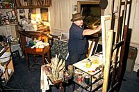 Painter at work in studio landscape