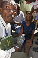 Girl being exorcised in Voodoo ritual, memorial day celebration one month after the January 2010 earthquake, Port au Prince, Haiti, West Indies, Carib...