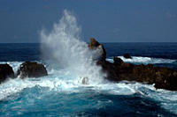 Waves crashing over St Peter and St Paul's rocks, Brazil, Atlantic Ocean