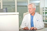 Doctor using computer at desk