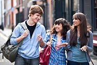 3 young people walking in street