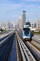Skyline and Dubai Metro, Modern Elevated Metro system, opened in 2010, Dubai, United Arab Emirates, Middle East