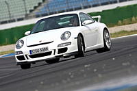 Porsche 911 GT3, model year 2006_, white, driving, diagonal from the front, frontal view, test track