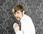 aggressive funny retro mustache businessman on vintage wallpaper
