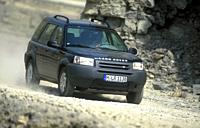 Car, Land Rover Freelander V6, cross country vehicle, model year 2001_, black, driving, offroad, diagonal from the front, Stone, Front view
