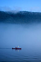 Kayaking from the Lindblad Expedition ship National Geographic Sea Lion in the fog in Tracy Arm in Southeast Alaska, USA Pacific Ocean No model or pro...