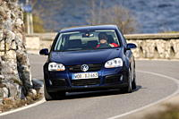 VW Volkswagen Golf GT 2.0 TDI, dark blue, model year 2005_, driving, diagonal from the front, frontal view, country road